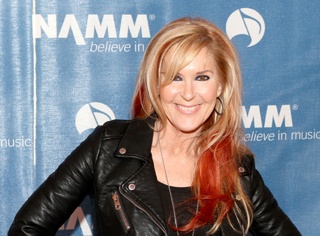 Guitarist Lita Ford attends the 2015 National Association of Music Merchants show at the Anaheim Convention Center on January 23, 2015 in Anaheim, California.  (Photo by Jesse Grant/Getty Images for NAMM)