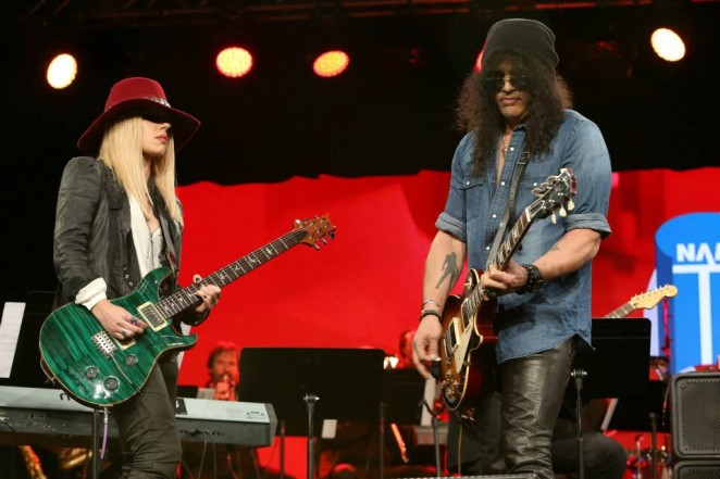 Slash and Orianthi (Photo by Jesse Grant/Getty Images for NAMM)
