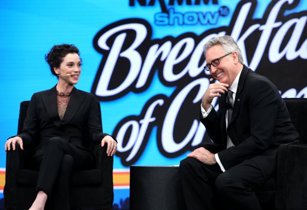 Annie Clark a.k.a St. Vincent and NAMM President and CEO Joe Lamond speak on stage at the 2016 NAMM Show Opening Day at the Anaheim Convention Center on January 21, 2016 in Anaheim, California. (Photo by Jesse Grant/Getty Images for NAMM)